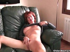 Redheaded grown-up dam plays with will not hear of nipples and pussy