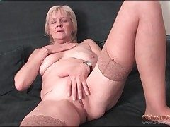Granny strips apropos stockings and fingers pussy